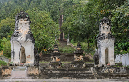 guarded: Burmese sculpted lions statue at stairways leading up to the hill at Wat Phra Non in Mae Hong Son, Thailand