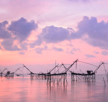 chinese fishing nets: Beautiful sunrise seascape with Chinese fishing nets or shore operated lift nets in Phatthalung, Thailand
