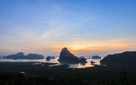 samet: Panorama of limestone karsts in Phang nga bay at sunrise.  Unseen place of Samed Nangshe or Samet Nangchee in Phang Nga province, Thailand. Stock Photo