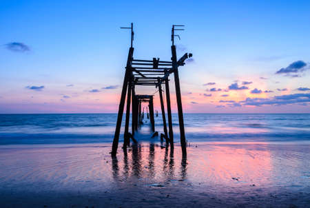 phang nga: Old abandoned wooden pier with seascape sunset skyline in Phang Nga province, Thailand