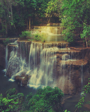 Huay Mae Khamin Waterfall, Paradise waterfall in Tropical rain forest of Thailand. Vintage filtered effect image