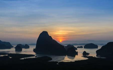 Panorama of limestone karsts in Phang nga bay at sunrise.  Unseen place of Samed Nangshe or Samet Nangchee in Phang Nga province, Thailand. Stock Photo