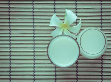 soymilk: Fresh Soy milk (Soya milk) on bamboo place mat with white plumeria flower. Retro-Vintage filter effect Stock Photo