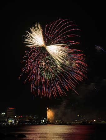 Colorful firework at Pattaya coast with cityscape background, Thailand Stock Photo