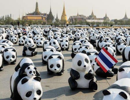 BANGKOK, THAILAND - MARCH 4, 2016: Exhibition of the 1,600 paper-mache panda sculptures world tour collaboration between WWF and French artist Paulo Grangeon at Sanam Luang in Bangkok, Thailand.