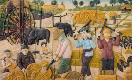 painting style: Stone carving of traditional Thai rural culture life in Thailand