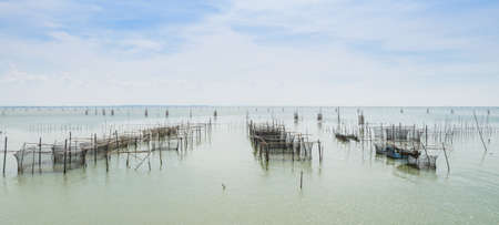 Fish farming in the sea with cages for rearing fish in Thailand Stock Photo