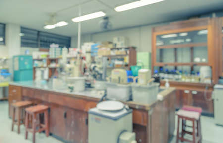 disarrangement: Blurred abstract background of workbench and equipment in chemistry laboratory. Scientific concept image