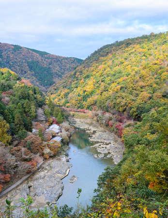 momiji: Beautiful aerial scenery of Asashiyama mountain and Hozugawa river in autumn season, Kyoto, Japan Stock Photo