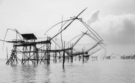 Silhouette Chinese fishing nets or shore operated lift nets in Phatthalung, Thailand. Black and white color image Stock Photo