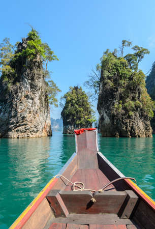 Beautiful limestone mountain ranges and natural attractions with long-tailed boat at Khao Sok National Park in Surat Thani Province, Thailand