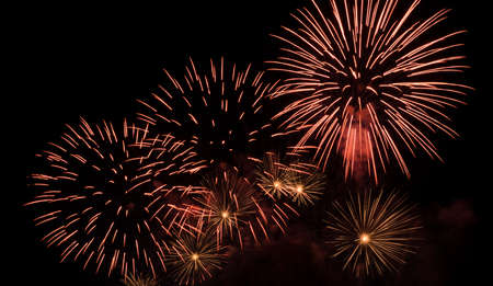 Colorful fireworks exploding in the night sky Stock Photo