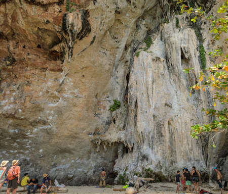 rapelling: Beautiful limestone mountain cliff and rock climbing activity at  Railay beach in Krabi Province, Thailand Stock Photo