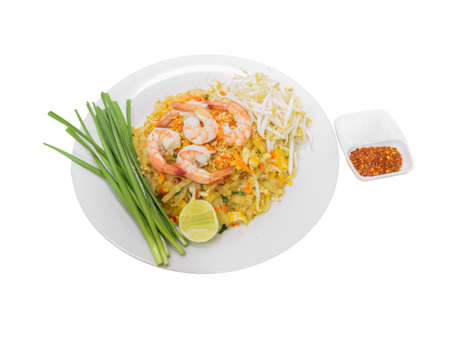Pad Thai, Stir-fried rice noodle with egg, tofu and shrimp isolated on white background. Famous Thai street food in Thailand