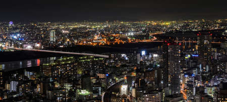 OSAKA, JAPAN - NOVEMBER 25, 2016 : Stunning night view of Osaka commercial and business cityscape from Umeda Sky Building in Osaka, Japan. Osaka is the second largest metropolitan area in Japan.