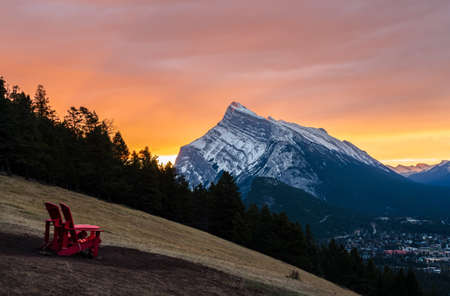 Stunning sunrise scenery of Mount Rundle and Banff town in Banff National Park in Alberta, Canada. Seen from a vantage point on the road to Mount Norquay.