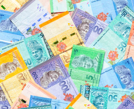 Malaysia currency of Malaysian ringgit banknotes background. Paper money of one, five, ten, twenty, fifty and hundred ringgit notes. Financial concept.