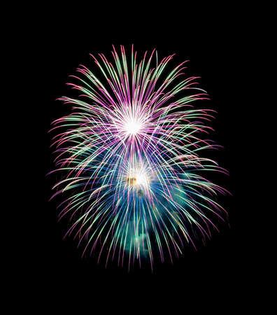 Night colorful fireworks on black background. Beautiful lights for celebration.