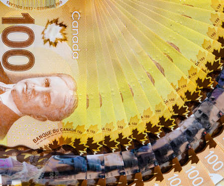 Canadian banknotes of hundred dollar bills background for business and finance concept 写真素材