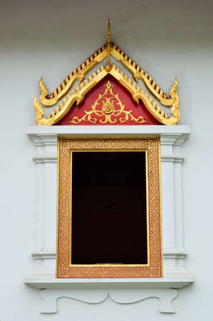 Ancient Window in Wat Phra Singh, Chiangmai,Thailand photo