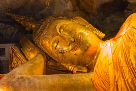 nirvana: Smile reclining buddha statue in nirvana position at Khaoluang Cave, Phetchaburi, Thailand