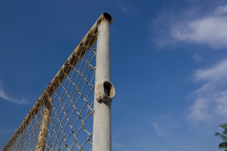 Chain link fence against evening sky Stock Photo - 20337224