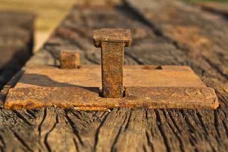 Old rusted sleeper bolt Stock Photo