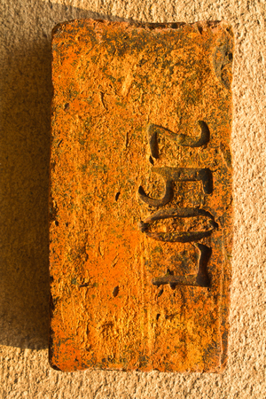 dated: An Old Brick dated  2507 B.E. (A.D.1964) Stock Photo