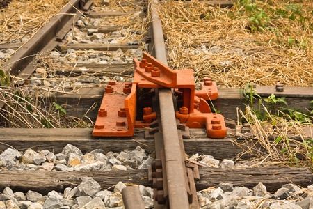 derail: De-Rail Device on Track during construction in a rail yard. Stock Photo
