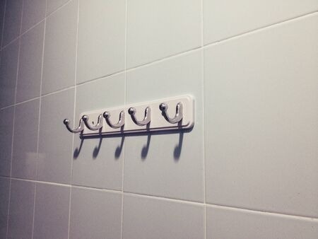 clothes rack: Clothes rack on the wall Stock Photo