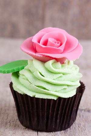 cupcake decorated with pink rose photo