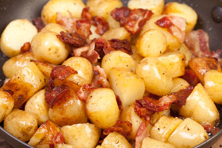 potatoes and bacon in the frying pan photo
