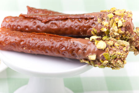snaps: three brandy snaps with pistachios