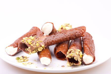 snaps: brandy snaps with cream in white background