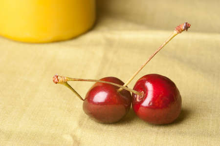 geen: Two cherries on geen background