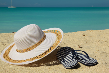 thongs: white beach hat and thongs on sand
