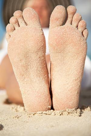 sandy feet: close up picture of women sandy feet