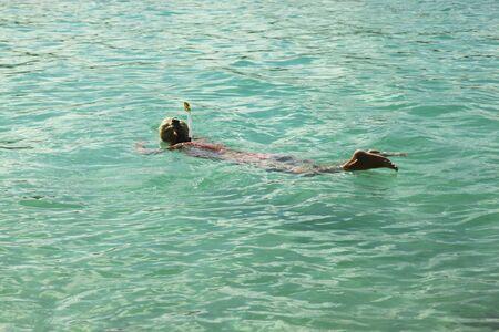 snorkling: picture of women snorkling in caribbean sea