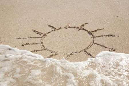 drown: sun drown on the sand half washed by wave