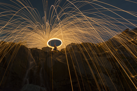steel wool: Abstract background from spinning steel wool on cliff at night time