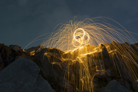 steel wool: Abstract from spinning steel wool on cliff at night time Stock Photo