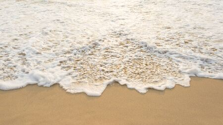 foot print: Sea wave and many foot print  on the beach background