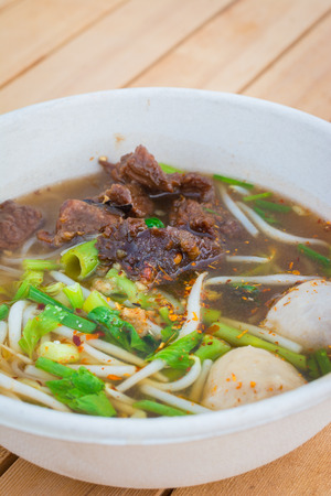 noodle soup: Noodle soup with beef in thai or chinese style on table background