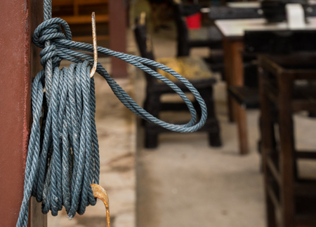 Coil of rope on a pole with blur background.