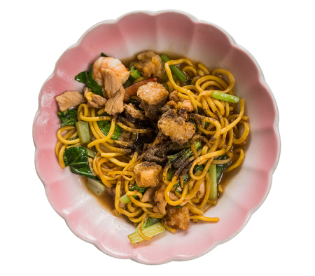 Fried yellow noodles or Hokkien mee on  white background, Clipping path