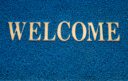 welcome mat: welcome carpet at the door texture background Stock Photo