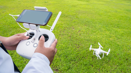 drones: Hand holding on remote for Control drone  Stock Photo