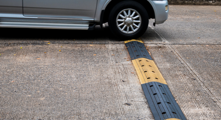 Car with road bumps for reduce speed. Stock Photo
