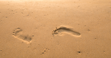 foot print: Bubbles waves and foot print on the beach  background Stock Photo