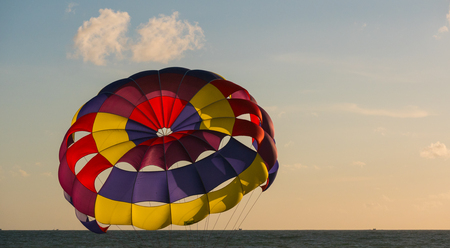 provide: Close - up Parasailing provide services to tourists on sky in sunset time